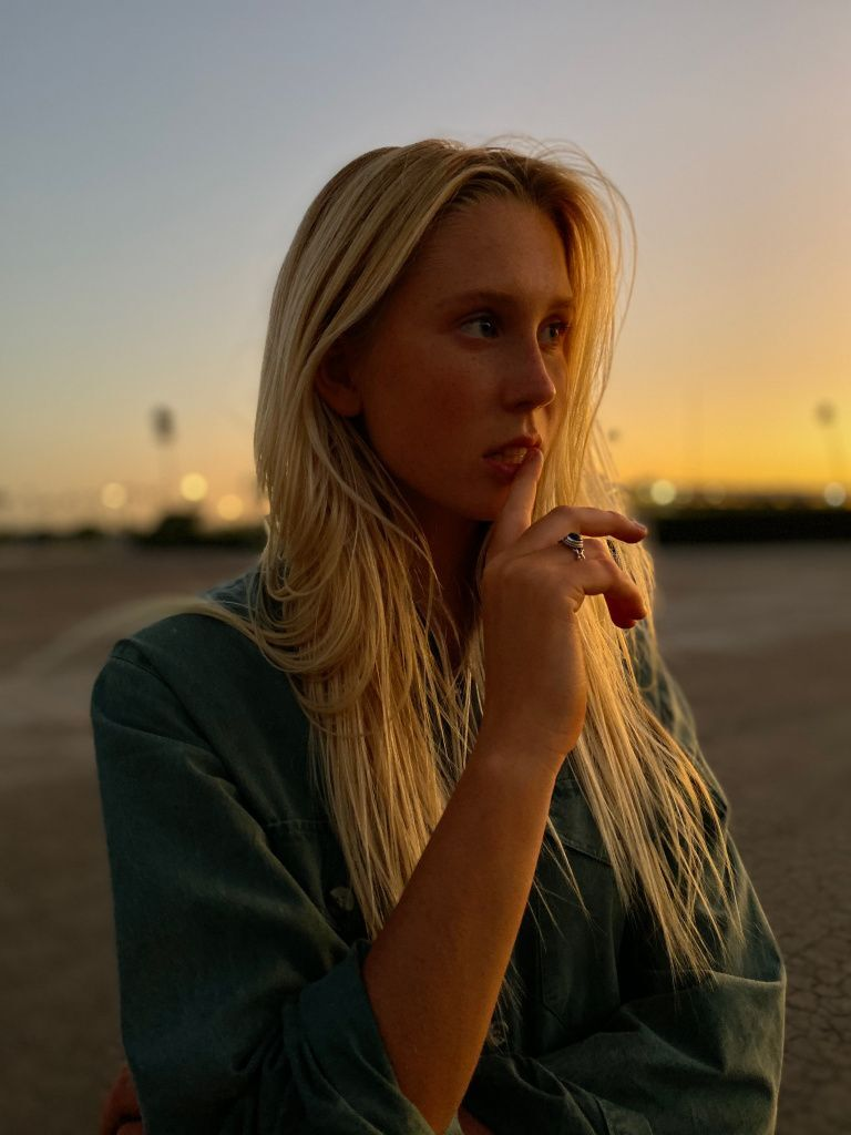 Apple_iPhone-11-Pro_Portrait-Woman-Sunset_091019.jpg